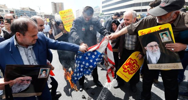 Iranian demonstrators burn a US flag during a rally in Tehran to show their support of Iran's decision to pull out from some part of nuclear deal. Photograph: Abedin Taherkenareh/EPA