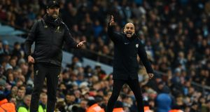 Man City Pep Guardiola   and Liverpool manager Jurgen Klopp react on the sidelines in January. Photograph: Getty Images