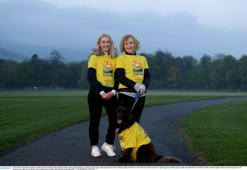 Sinead Bennett from Dundrum, Dublin, with her daughter Niamh and their dog Sunny at the Darkness Into Light event at Marlay Park in Rathfarnham, Dublin. Photograph: Erin Noonan/Sportsfile