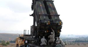 In this file photo taken on February 2013, US soldiers work on a Patriot missile system at a Turkish military base in Gaziantep. Photograph: Bulent Kilic/AFP