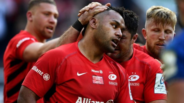 Billy Vunipola of Saracens is congratulated after scoring his try. Photograph: Stu Forster/Getty Images