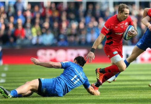 Liam Williams of Saracens slips inside James Lowe of Leinster. Photo: Andrew Fosker/Inpho