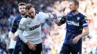 Derby's Richard Keogh clashes with Leeds' Liam Cooper. Photograph: Clive Mason/Getty