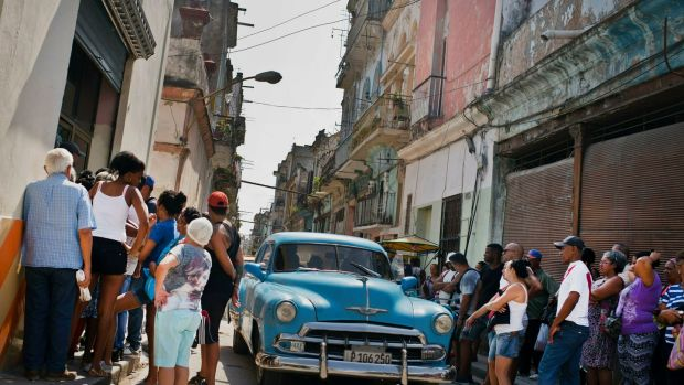 People wait in line to buy chicken at a government-run grocery store in Havana, Cuba, Saturday, May 11th, 2019. Photograph: Ramon Espinosa/AP Photo