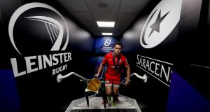 Saracens' Sean Maitland brings the Heineken Champions Cup into the dressing room after the game. Photograph: Gary Carr/Inpho
