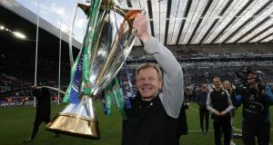 Mark McCall with the Champions Cup trophy after his side's win over Leinster. Photograph: Billy Stickland/Inpho