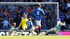 Scott Arfield scores Rangers' second against Celtic. Photograph: Russell Cheyne/Reuters