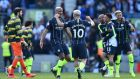 Manchester City celebrate after securing the title with a 4-1 win over Brighton. Photograph: Glyn Kirk/AFP/Getty