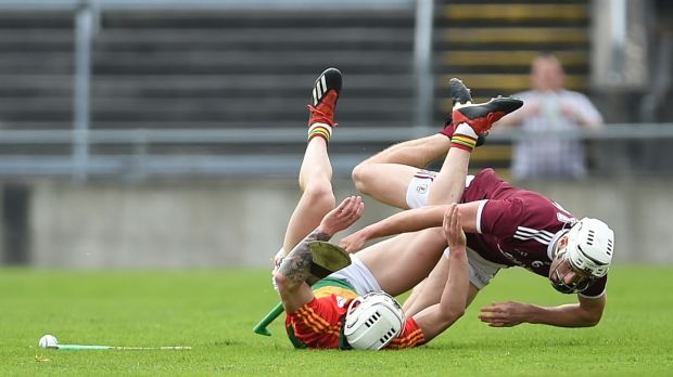 Carlow's James Doyle and Gearoid McInerney of Galway collide. Photograph: Tommy Grealy/Inpho