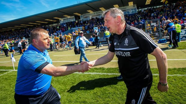 Waterford manager Paraic Fanning with Clare joint manager Donal Moloney after the game. Photograph: Ryan Byrne/Inpho