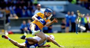 Waterford's Shane Fives and Shane O'Donnell of Clare. Photograph: Ryan Byrne/Inpho