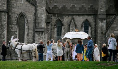 Communion celebrants pose for photographs in the gardens at St Patricks Cathedral Dublin.  Photograph Nick Bradshaw/The Irish Times