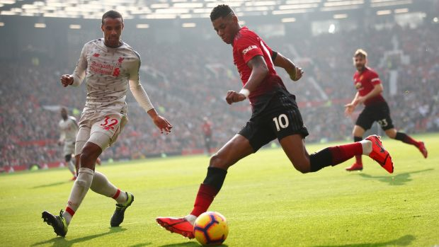 Joel Matip challenges Marcus Rashford during Liverpool's goalless draw with Manchester United at Old Trafford. Photograph: Clive Brunskill/Getty