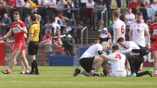 Derry's Padraig Cassidy receives a yellow card for a high challenge on Michael McKernan of Tyrone. Photograph: Lorcan Doherty/Inpho