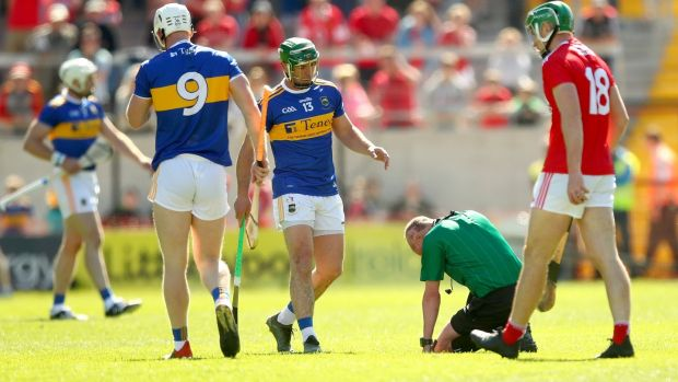 Referee Seán Cleere injured after being hit. Photograph: James Crombie/Inpho
