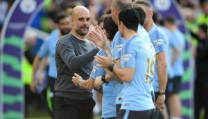 Manchester City manager Pep Guardiola celebrates winning the Premier League title following their 4-1 defeat of Brighton & Hove Albion  at American Express Community Stadium. Photograph: Mike Hewitt/Getty Images