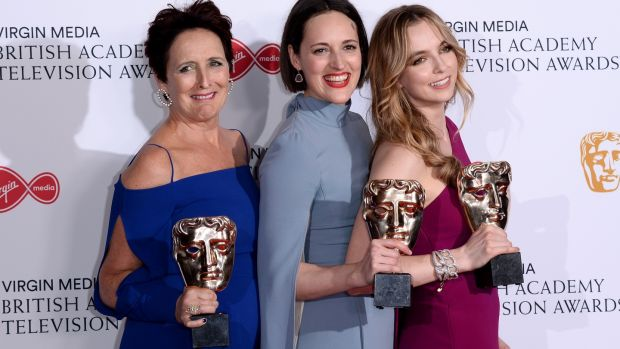 Fiona Shaw, Phoebe Waller-Bridge and Jodie Comer with their TV Baftas for Killing Eve. Photograph: Jeff Spicer/Getty Images