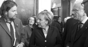 John Holten of Broken Dimanche Press with Angela Merkel