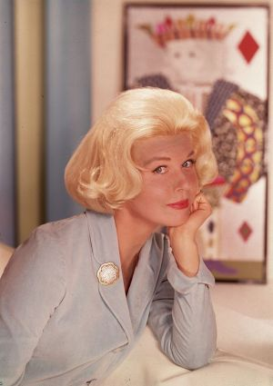 Doris Day  in front of a wall hanging of the king of diamonds, circa 1950.  Photograph:  Hulton Archive/Getty Images