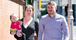 Nicola Cox Coghlan with her husband Ross Coghlan and their  daughter  Anne-Marie Coghlan outside  the Coroner's Court in Dublin. Photograph: Tom Honan.