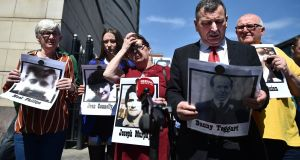 Relatives of those killed in what became known as the Ballymurphy Massacre are pictured outside an inquest at  Laganside Courts. Photograph:  Charles McQuillan/Getty Images.