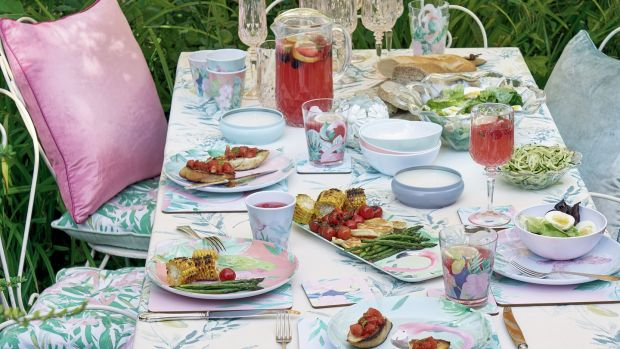 Some old-fashioned florals from Laura Ashley brings life to your outdoor furniture.