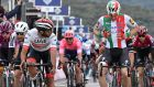 Colombian rider Fernando Gaviria of the Uae Team Emirates and Italian rider Elia Viviani of the Deceuninck-Quick Step team react after crossing the finish line of the third stage of the Giro d'Italia. Photograph: EPA
