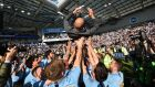 Manchester City  manager Pep Guardiola is thrown into the air by his players as they celebrate after their 4-1 victory against Brighton  to become  Premier League champions for a second consecutive year. Photograph: Glyn Kirk/AFP