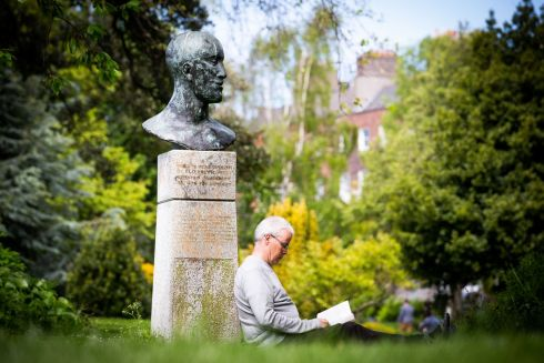 'GIVE US A LOOK': Brendan Carney from Dublin reading his book in Merrion Square. Photograph: Tom Honan