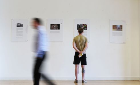 ONE IN FOUR: Visitors at the CHQ building in Dublin's George's Dock viewing the I am One in Four exhibition of photographs and words produced by people who have experienced childhood sexual violence. Photograph: Nick Bradshaw
