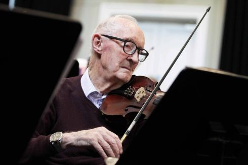 LIMBERING UP: Denis O'Callaghan (93) with other members of the Blow the Dust Orchestra rehearsing for their 10th Anniversary Concert on June 4th at the National Concert Hall. Photograph: Mark Stedman