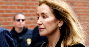 Actor Felicity Huffman arrives at the federal courthouse to face charges in a nationwide college admissions cheating scheme in Boston, Massachusetts. Photograph: Katherine Taylor/Reuters.