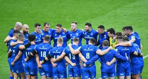 Leinster players huddle as they come to terms with their defeat in the Champions Cup final. Photograph: Reuters