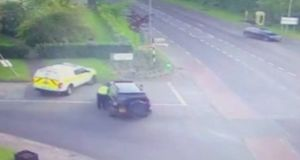 A videograb shows a garda approaching an SUV in Co Tipperary