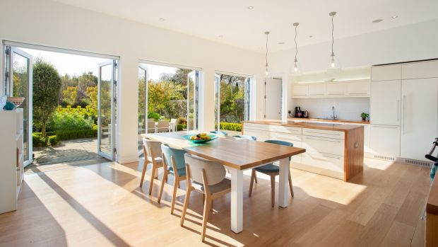 A bespoke Andrew Ryan kitchen is a welcoming space with a warm hardwood finish