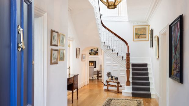 An elegant original staircase stands to the rear of the large entrance hall
