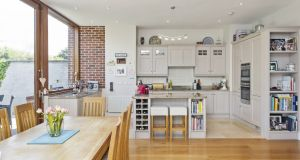 The brick detail in the kitchen is followed through to the outside walls of the extension