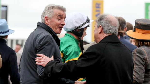 Cheltenham Racing Michael O'Leary with JP McManus at Cheltenham this year. Photograph: Dan Sheridan/Inpho