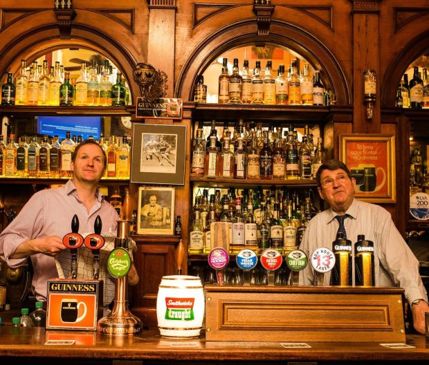 Pub crawl: father and son Willie and Liam Aherne at the Palace Bar in Dublin. Photograph: Elaine Hill