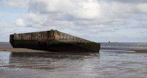 The remains of a D-Day Mulberry harbour at Arromanches, Normandy. Photograph: iStock