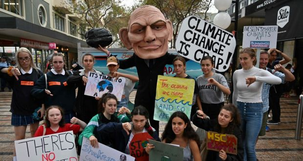 Schoolchildren stage a climate change protest in Sydney, Australia, earlier this month. When they graduate, will they want to work for a fossil fuel company? Photograph:  Saeed Khan/AFP/Getty Images