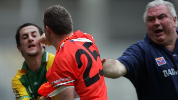 Kerry's Paul Galvin tangles with Armagh maor foirne John Toal as manager Joe Kernan tries to intervene during the 2006 championship. Both players received red cards which hurt Kerry more than Armagh. Photograph: Lorraine O'Sullivan/Inpho