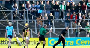 Referee Cathal McAllister admonishes Grey Kennedy as he returns to the sideline after catching the ball from Kilkenny's TJ Reid's quickly-taken short free at Nowlan Park. Photograph: Ryan Byrne/Inpho
