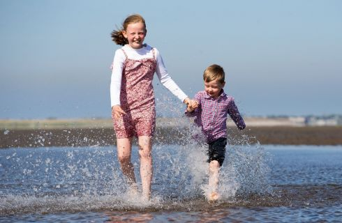 Susanne  Ryan (8) and Stephen Ryan (4) from Clontarf on Dollymount Strand, Dublin this afternoon. Photograph: Tom Honan/The Irish Times.