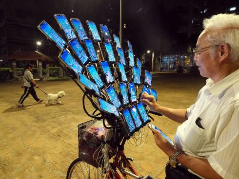 A 70-year-old Feng Shui master uses 29 mobile phones mounted on his bike and two hand-held phones to catch Pokemon in New Taipei City, Taiwan. Chen was hooked on Pokemon Go in 2016 when his grandson taught him how to play the game. Photograph: David Chang/EPA