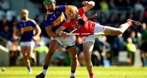 Tipperary's James Barry and Declan Dalton of Cork. Tipperary were the story of the weekend. Photograph: James Crombie/inpho