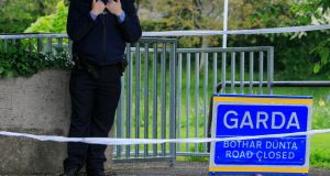 A Garda at the scene of a fatal stabbing in Finsbury Park, Dundrum, Dublin. Photo: Gareth Chaney Collins