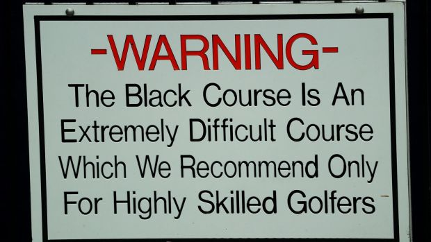 The famous warning sign behind the first tee. Photo: Mike Ehrmann/Getty Images