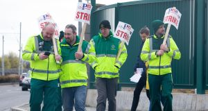 National Ambulance Service  staff take part in a picket outside an ambulance station on Dublin's Davitt Road last month. Photograph: Tom Honan