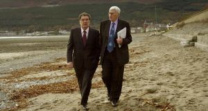 John Hume  (left) and Seamus Mallon  walk on the strand at the Slieve Donard Hotel, in Newcastle during a break from the SDLP annual conferece on November 18th, 2000. Photograph: Matt Kavanagh